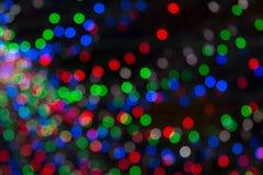 黄色,黑暗,红色,蓝色背景 在bokeh的圣诞灯 Boken 库存图片