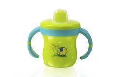 绿色婴孩杯子 免版税图库摄影
