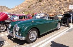 绿色1958年捷豹汽车XK 150 免版税图库摄影