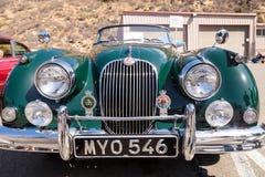 绿色1958年捷豹汽车XK 150 免版税库存照片