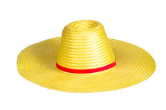 黄色织法塑料帽子 免版税图库摄影