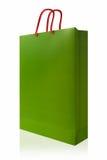 绿色购物袋,隔绝与在白色backgro的裁减路线 库存图片