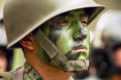以绿色绘的战士面孔 免版税库存图片