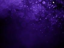 紫色紫罗兰色bokeh摘要背景和纹理 免版税库存照片