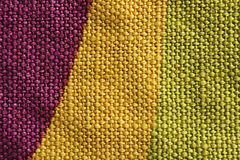 黄色紫色和绿色织品纹理 库存照片