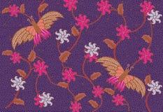 紫色蝴蝶蜡染布 免版税库存照片