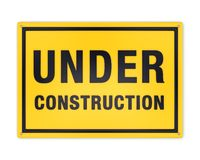黄色建设中标志 免版税库存照片