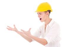 黄色建造者盔甲呼喊的恼怒的女商人建筑师 库存图片
