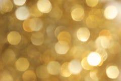 黄色Chrsitmas Bokeh背景 库存图片