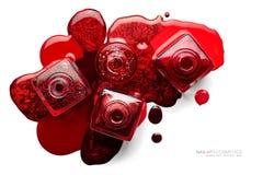 艺术化妆用品图象 套时髦红色指甲油 库存图片