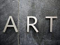 艺术在不锈钢上写字 库存图片