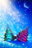 艺术在蓝色夜背景的圣诞树 免版税库存图片