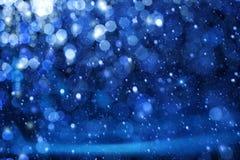 艺术在蓝色背景的圣诞灯 免版税库存图片