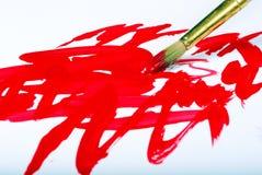 艺术家刷子和红色绘画的技巧在白色 库存照片