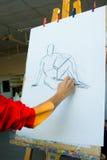 艺术家图画年轻人 图库摄影