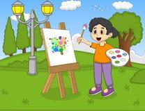 艺术家在帆布的女孩绘画在公园动画片 免版税库存图片