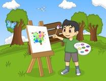 艺术家在帆布的男孩绘画在公园动画片 免版税库存照片