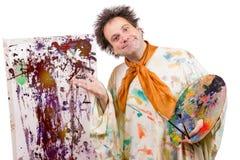艺术家显示现代艺术他的工作  免版税图库摄影