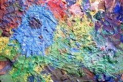 艺术家用不同的颜色的` s调色板 木头 各种各样的colors.spiral笔记本 纹理 库存图片