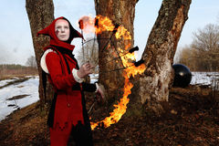 艺术性的小丑火诉讼妇女 图库摄影