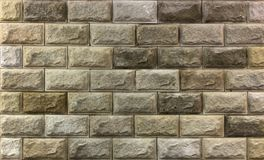 艺术性的砂岩墙壁纹理背景样式 免版税库存图片