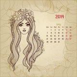 艺术性的葡萄酒日历2014年7月。妇女 库存照片