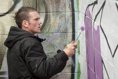 艺术男孩少年街道画的绘画 库存照片
