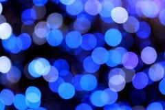 节假日发光的蓝色模糊的光bokeh 免版税库存照片
