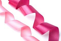 节假日查出的桃红色丝带 免版税库存图片