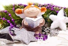 节假日设计的新年度看板卡与天使 免版税库存照片