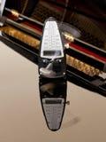 节拍器钢琴被反射的滴答作响 免版税库存照片