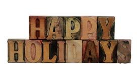 节日快乐活版在木头上写字 库存照片