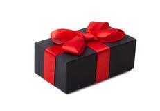 节日礼物。 有一把红色弓的黑匣子。 图库摄影