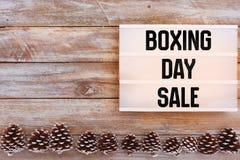 节礼日在lightbox的销售文本在冬天桌上 免版税库存照片