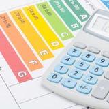 节能图和计算器-接近  免版税库存照片