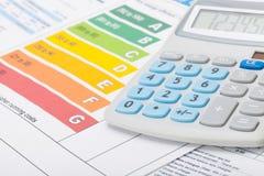 节能图和计算器 免版税库存图片