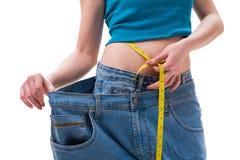 节食的概念与过大的牛仔裤 免版税库存图片
