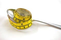 节食的评定匙子磁带 库存图片