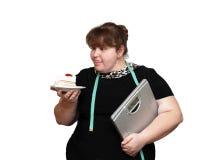 节食超重妇女的蛋糕 免版税库存图片