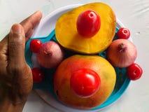 芒果、菜和欢欣 免版税图库摄影
