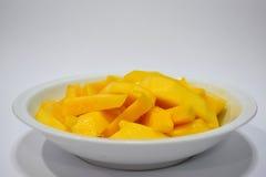 芒果烹调与水花 库存照片