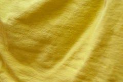 芥末颜色垂悬的织品与波浪的 图库摄影
