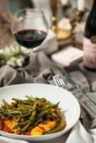 芦笋豆和南瓜在西红柿酱 库存图片