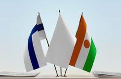 芬兰和尼日尔的旗子 图库摄影