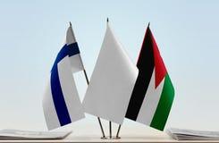 芬兰和约旦的旗子 免版税库存图片