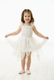 芭蕾服装的笑的小女孩 免版税库存图片
