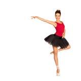 黑芭蕾舞短裙裙子的美丽的芭蕾舞女演员 图库摄影