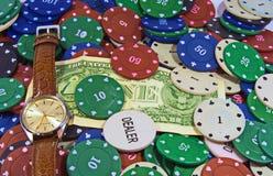 芯片,金钱,手表 免版税库存照片