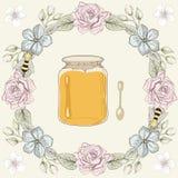 花卉框架、蜂蜜瓶子和蜂 免版税库存照片