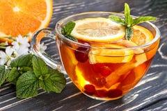 花卉茶橙色蔓越桔薄菏冰 库存照片